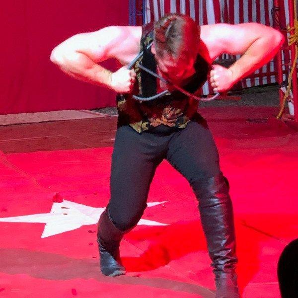 Circus Strongman Bending Iron