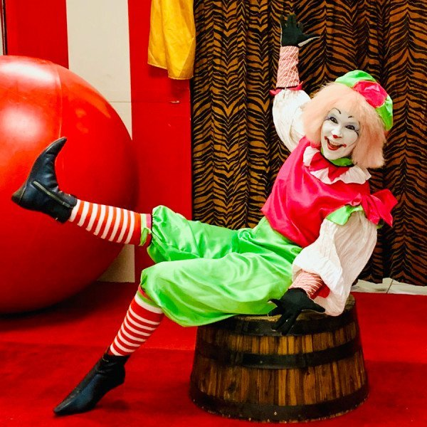 Circus Clown sitting on barrel